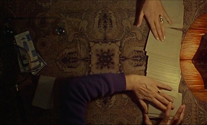 IMAGE: Still - 01 Two hands dealing cards